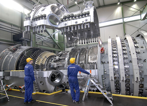 A Siemens SGT5-8000H gas turbine during final assembly. Siemens Energy produces gas turbines with capacities up to 400 MW; steam turbines up to 1,900 MW, and generators up to 2,235 MVA.