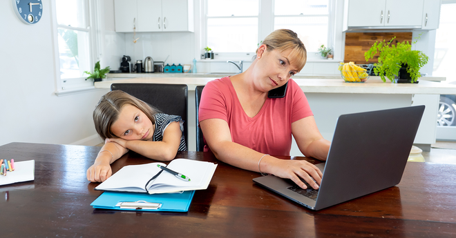 Mother Working From Home With Kid