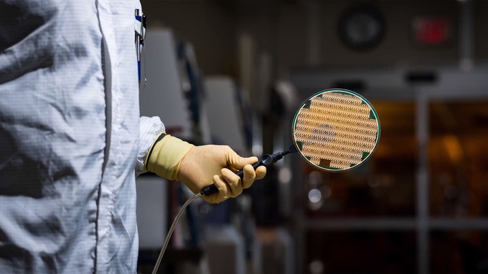GaN and GaAs 6-in. diameter semiconductor wafers are part of a foundry that serves both military and commercial customers. (Courtesy of BAE Systems)