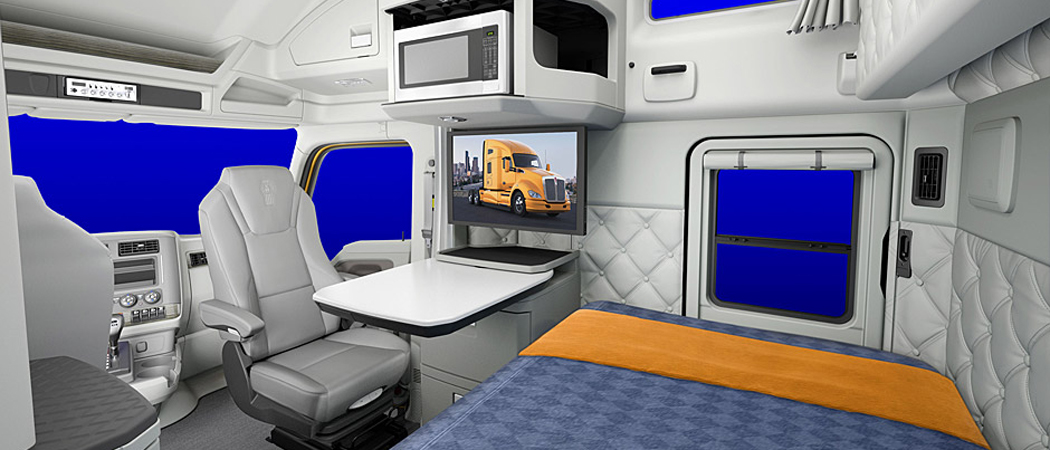 Kenworth offers an optional Driver's Studio package that allows the passenger seat to swivel and become part of the sleeper cab layout.