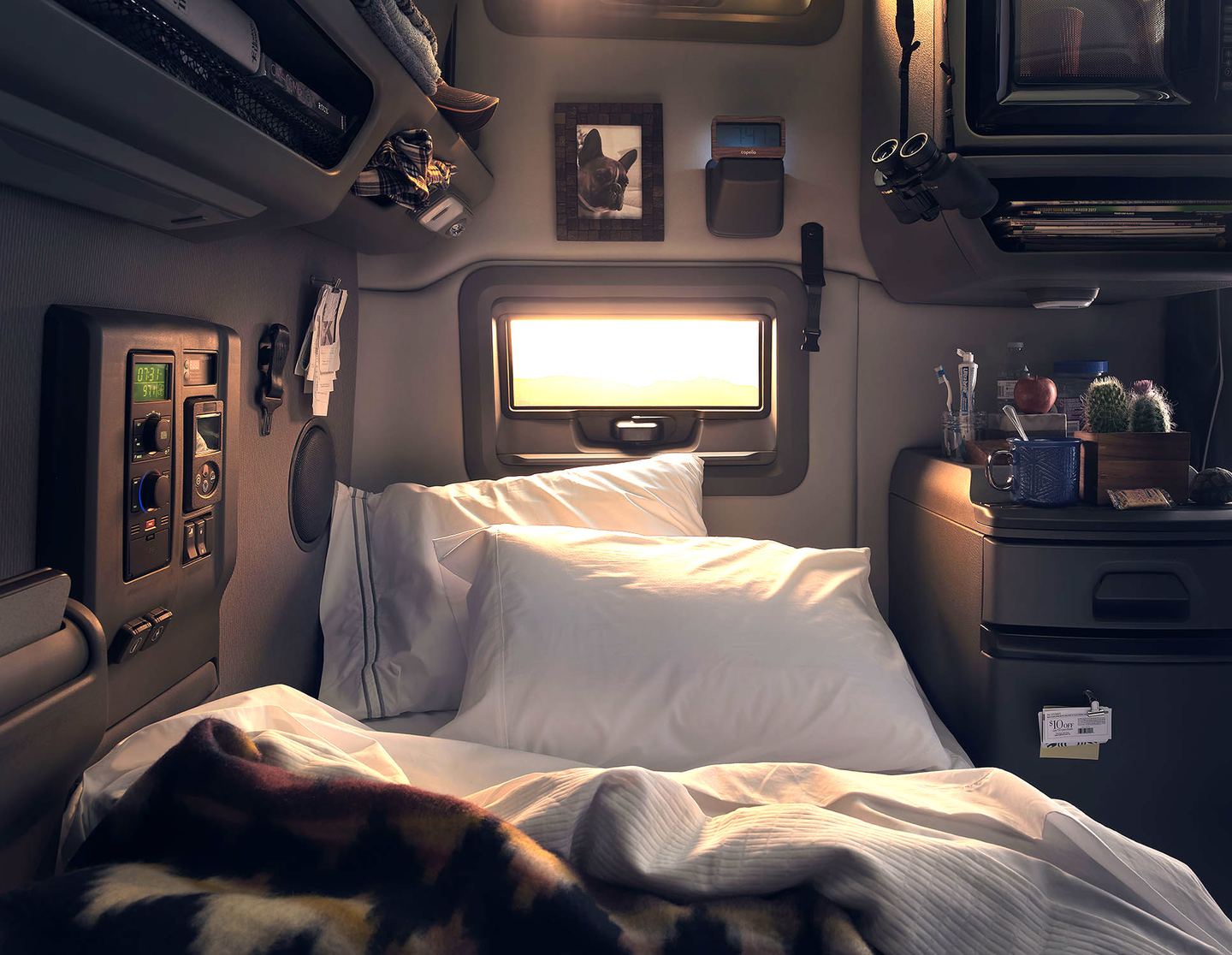 The Volvo VNL sleeper cab puts the control panel next to the lower bunk and offers lighting control, locks, an inverter, charging and audio ports.