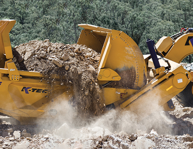 A K-Tec 1243 moves dirt on an airport project.
