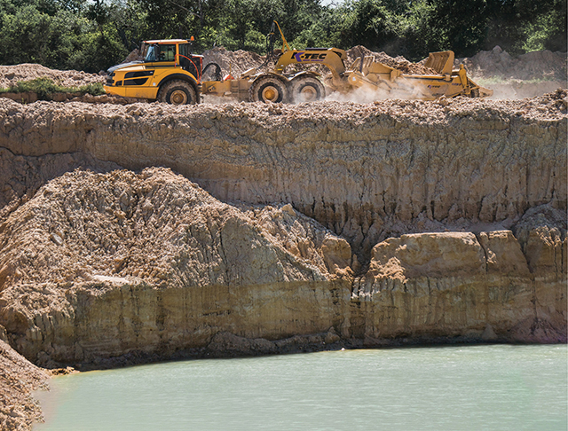 A K-Tec 1237 ADT working at a sand quarry