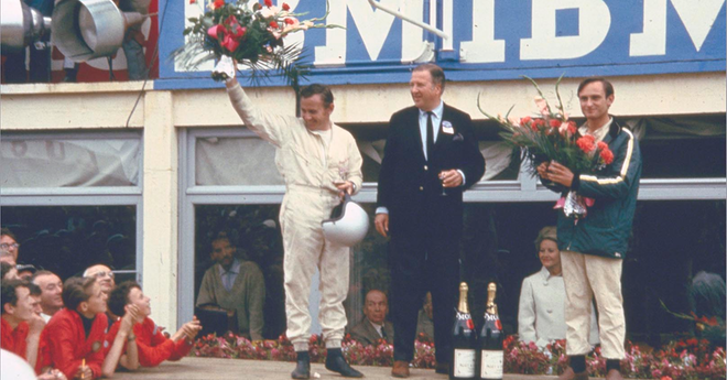 Bruce McLaren, Henry Ford II and Chris Amon on the victory rostrum at 24 Hours of Le Mans 1966.