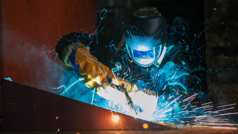 Worker Welding Metal Beautiful Sparks Istock Getty Images Plus