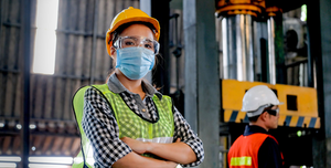 Factory Worker In Mask
