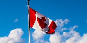 Canadian Flag In Front Of Blue Sky With Some White Clouds © Nestor Arturo Velasco Diaz Dreamstime