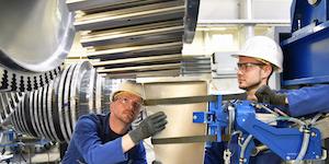 Industrial Hard Hat Workers Assembling Steel Turbine Parts © Industryviews Dreamstime
