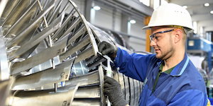 Industrial Worker Assembling A Turbine © Industryviews Dreamstime