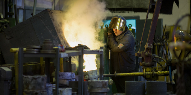 Man Pours Metal Into Molds At Steel Mill © Alexander Khitrov Dreamstime