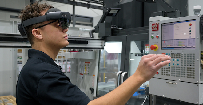 PBC Linear machine operator uses AR equipment to go through work instructions for a job on the Haas machining center. (Credit: PBC Linear)