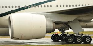 Boeing 777 Engine Undercarriage Landing Gear Tarmac Airport Runway © Tommy Beattie Dreamstime