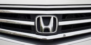 Honda Logo On Grill Of Grey Car © Vyacheslav Bukhal Dreamstime
