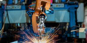 Close Up Industrial Robot Welding Automatic Arm Car Vehicle Factory Sparks Nice Weld © Thossaphol Somsri Dreamstime