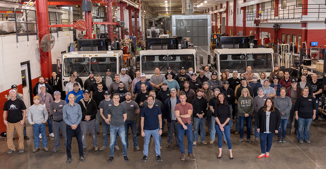 The Crane Carrier workforce gathers in the plant with new leadership.
