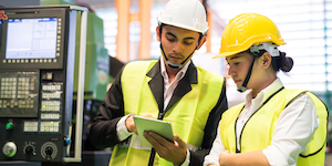 Factory Workers Use Tablet Reflective Vests Hard Hats Helmets Yellow Jobs Employment © Blanscape Dreamstime