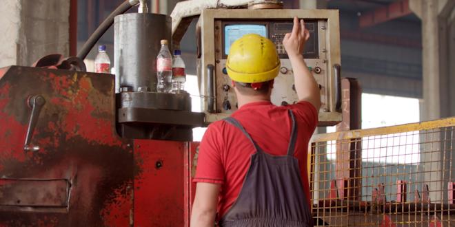 Employee In Helmet Operating Metal Process Machinery © Serhii Shchehlov Dreamstime