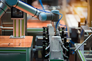 Image Robotic Arm Machine In Factory Picked Up The Plastic Bottle Packaging For Food