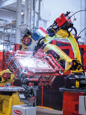 Handling-to-Welding welding cell: the handling robot positions the workpieces while the second robot performs the welding.