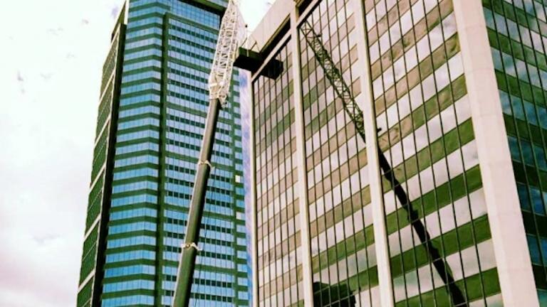 Sims Crane Posts Video Of Crane Lifting Generator To 18th Floor Of