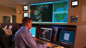 A Blue Ridge Electric system operator monitors an outage map.