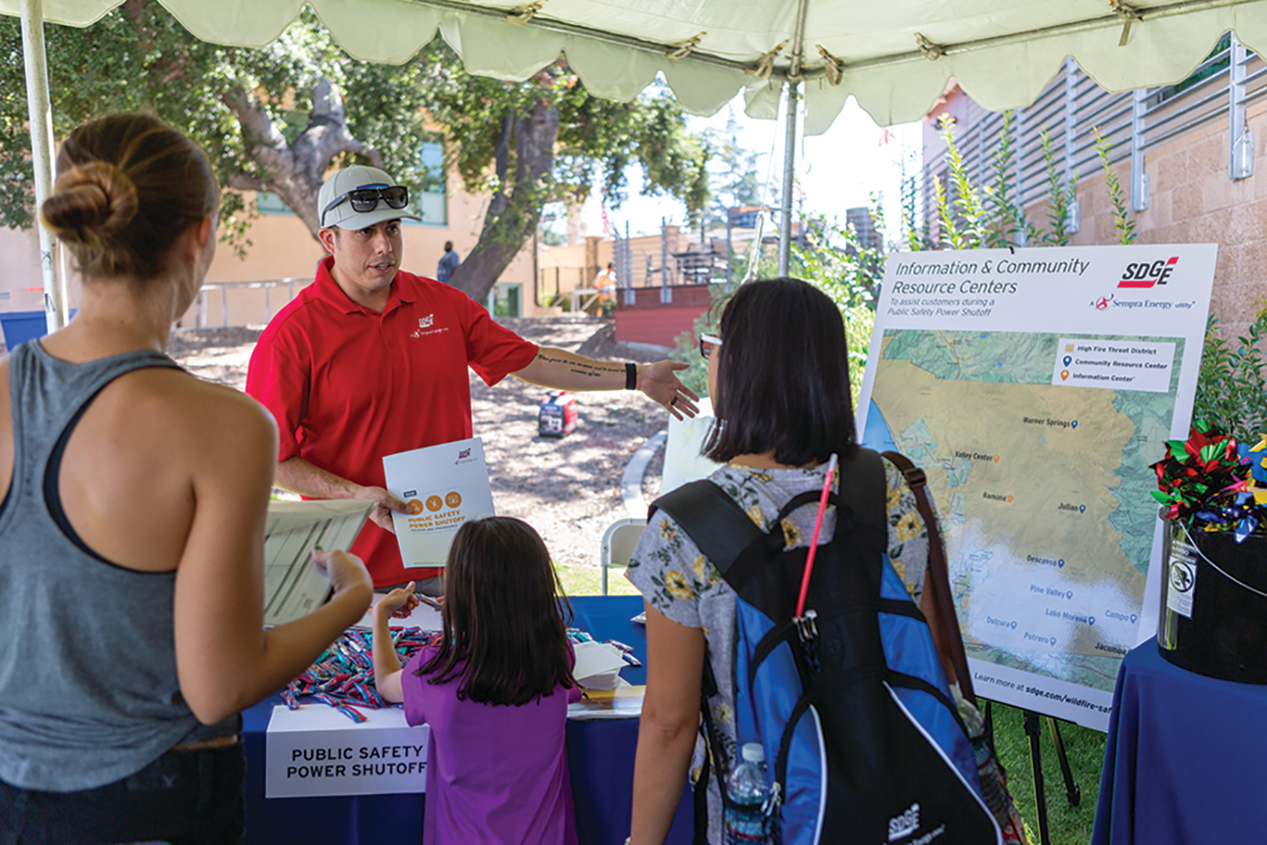 SDG&E representative meeting with community members at the SDG&E Wildfire Safety Fair.