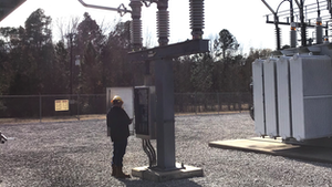 Brandon Lankford, WCEC power quality technician, performs an inspection on a circuit switcher.