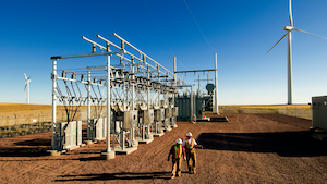 Workers By Substation Wind Turbine