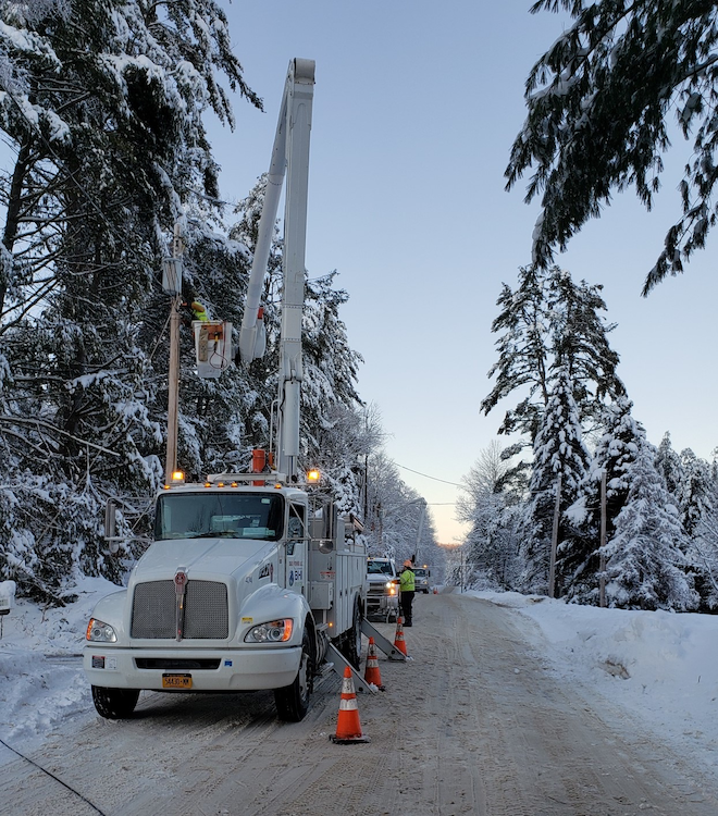 Crews worked in Thurman, New York, to replace a broken pole and damaged transformer due to heavy ice and snow conditions that brought down tree limbs and sagged pine trees onto the lines following Winter Storm Kade in February 2020.