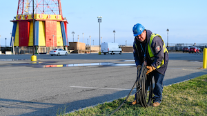 Con Edison's emergency operations supervisor Al Marchione rolling out the cable that will be installed to feed the temporary shed to power Coney Island Hospital MCU Park Brooklyn