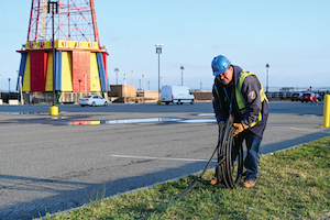 Con Edison's emergency operations supervisor Al Marchione rolling out the cable that will be installed to feed the temporary shed to power Coney Island Hospital MCU Park Brooklyn.