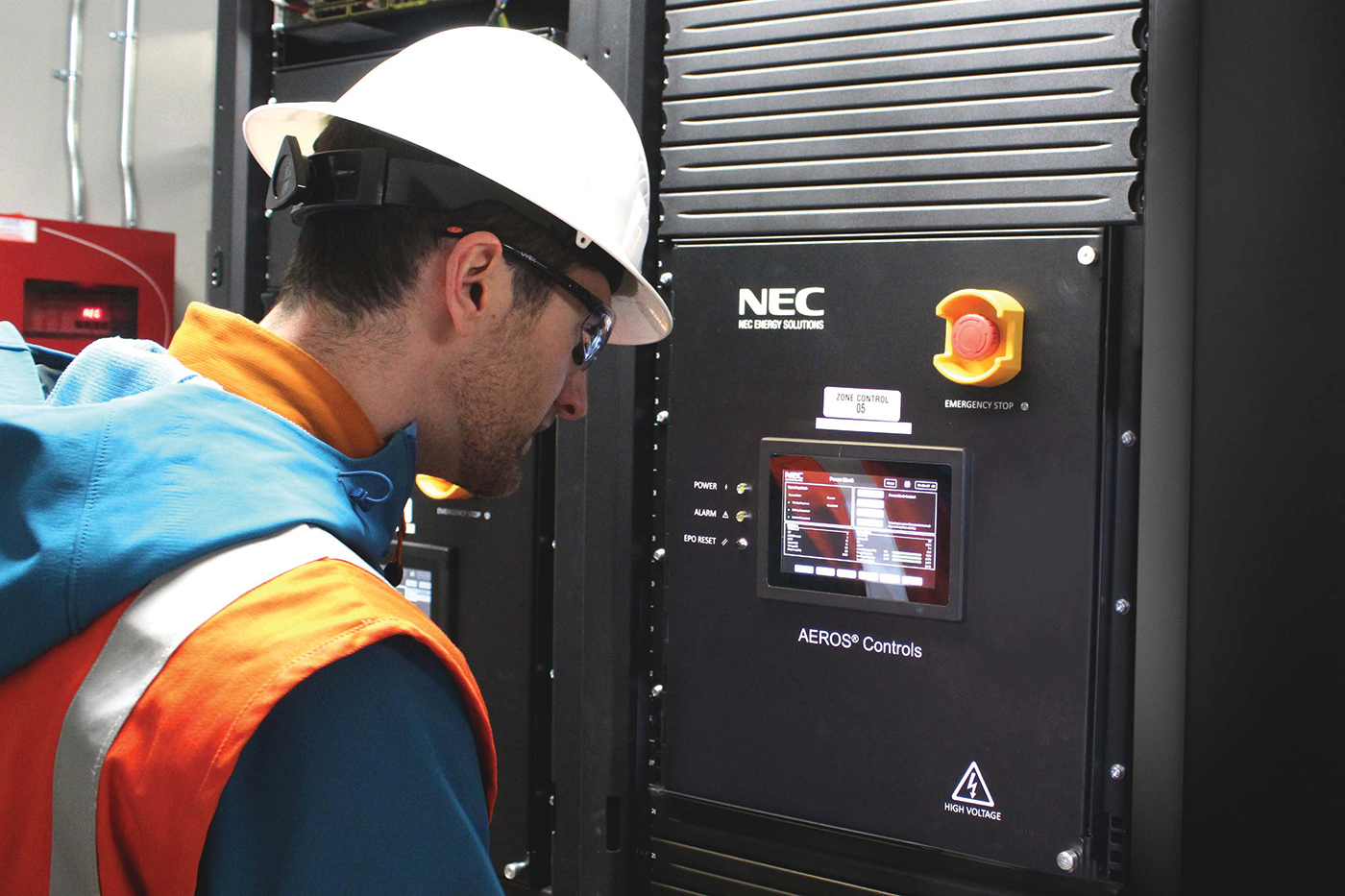 Key Capture Energy employee, Jim Brown, inspecting the controls software inside of the KCE NY 1 battery storage project.