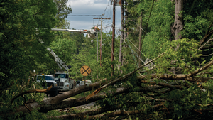 Entergy Texas crews and other contractors work to clear debris, set new poles and restore power in downtown Smackover, Arkansas, on April 14, 2020.