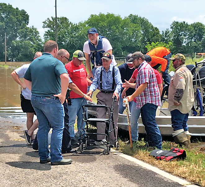 Entergy's employees assisted a customer using an airboat following a flood.