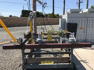 Phase-to-phase contact with vegetation on covered conductor, energized at 12 kV. Current was measured at 0.001 mA.
