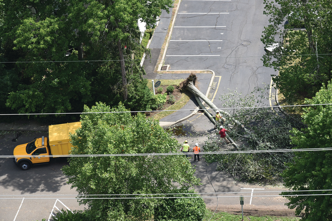 Crews respond to a downed tree near the Clock Hill Condos in Darien, Connecticut, on Aug. 10.