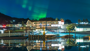 The aurora borealis appears over Cordova's town center. About 2,300 people live in the town year-round.